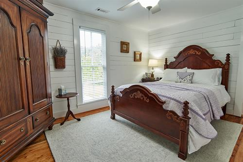 Lavender room with queen bed and private bathroom.