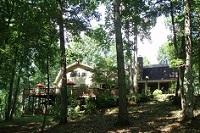 Enjoy natural woodlands from wrap around deck