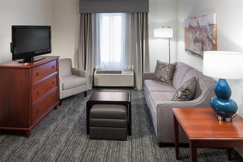 Enjoy living rooms in each suite!