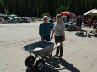 These customers needed a wheelbarrow for all the great deals at the Yard Sale!