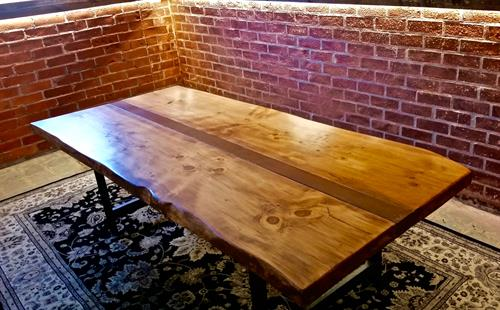 Live edge conference table with steel beam.