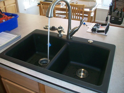Double sink and faucet/disposal install on a new island.