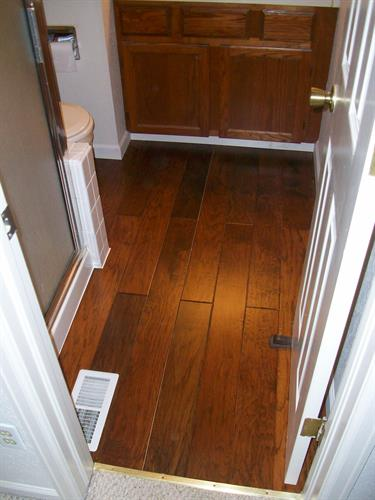 Pergo flooring install in a bathroom.