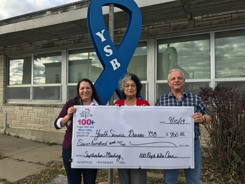 Kevin & Denise Franz presenting the September 2019 donation to Youth Services Bureau (YSB) Alice Berogan, Hispanic Services Worker