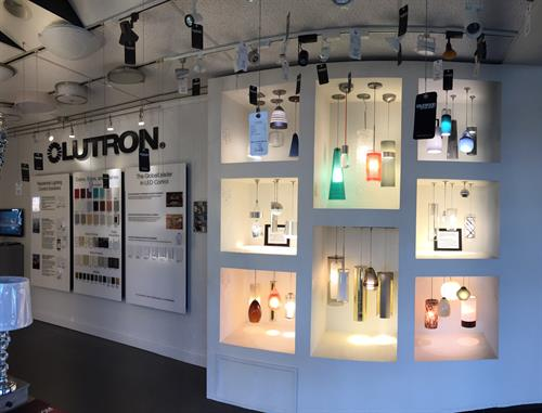 Lightboxes showcasing pendants from Tech Lighting and LBL at Idlewood Electric. NEW Lutron display features swatch finishes for dimmers and showcases Lutron Caseta Wireless Control System. Battery-Operated Shades by Lutron are also offered at Idlewood Electric.