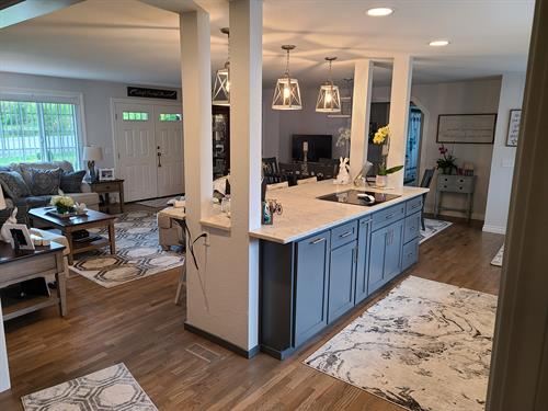 and open concept kitchen, dining and living rooms.