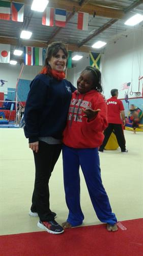 Coach Ita with one of her students