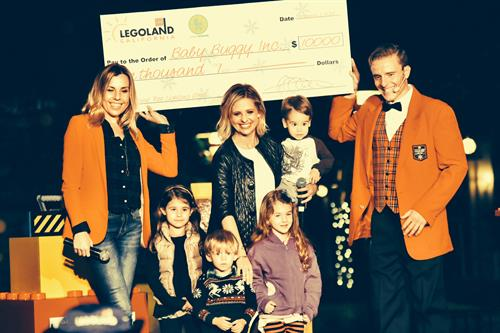 Baby Buggy Receiving a $10,000 Check from LEGOLAND California