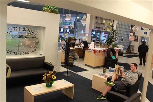Customer waiting area.  Flat screen, popcorn, gourmet coffee, water and comfortable seating