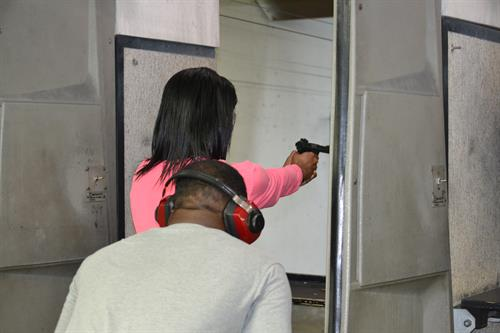 Student demonstrating proper grip and stance while shooting at the target