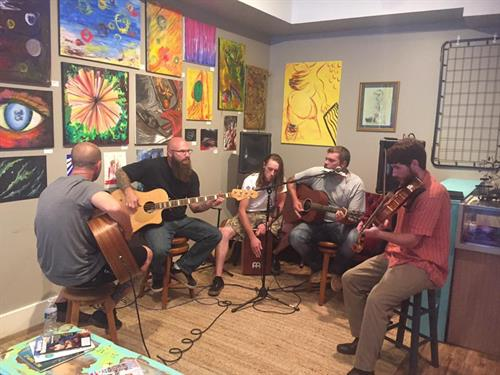 Every 2nd Friday, OTS7 participates in the Friday for the Arts! in Old Towne, and we have a new art show hanging as well as acoustic musicians.  (Photo is of Campbell's Bridge Band)