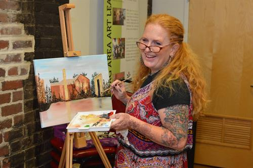 Denise painting live at a fundraiser.
