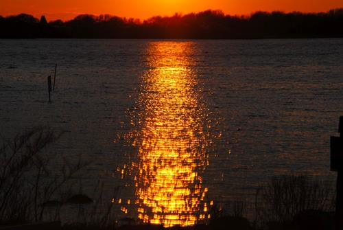 End your day with a view of the sun setting on Ninigret Pond