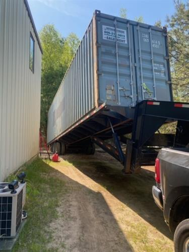 Used storage container delivery