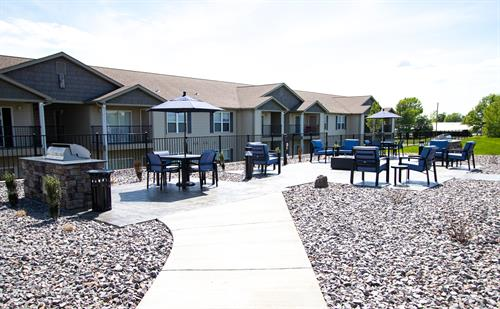Icon Community - Amenities (Hilltop Apartments behind grilling / fire pit station)