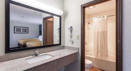 Sink and bath area in our standard queen sized double-beds