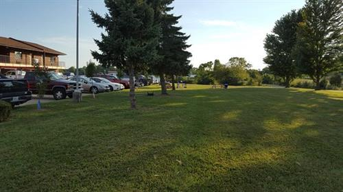 We also have large grassy areas to play out-door games, sit at the picnic tables with your family or even BBQ with out charcoal grill!