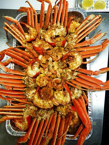 The Krackin feeds up to 10 people with 13 crab clusters, 75 shrimp, 5 full or 10 half lobster tails, 8 corn and 2 pounds of potatoes!