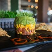 Start off with one of our many appetizers. Pictured is our fresh Ahi Tuna Tower.
