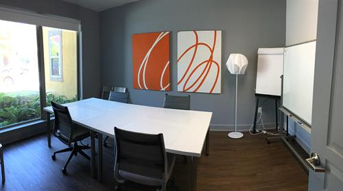 Conference Rooms Available Monday - Friday, 9am - 5pm. Large Conference Room Seats 6 (or up to 10 with additional occasional chairs) / Large Whiteboard with Markers / Projector Access to coffee and tea vending / Sodas and Snacks or catering available for additional fee.
