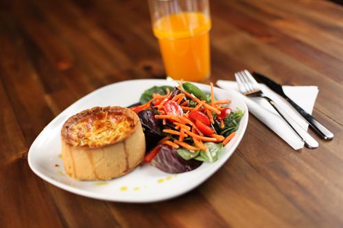 Quiche with a choice of house salad or Caesar salad.