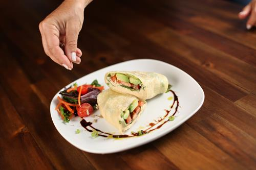 Lakota crepe: Hummus, tomato, avocado, sunflower seeds & spinach. Gluten-free.