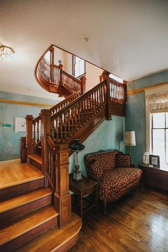 Lobby with its craftsman-style stairs going up to the second floor