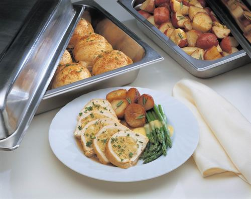 Our delicious Roasted Stuffed Chicken with red potatoes and asparagus.