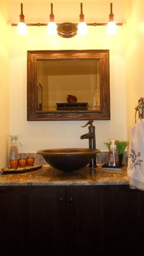 After Powder Room New vanity, depressed copper vessel sink & pump tap, new lighting & painted walls