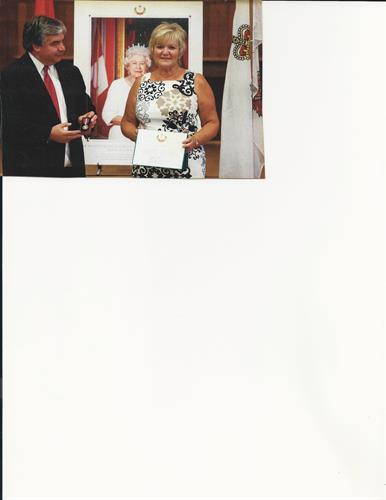 Accepting Queen's Diamond Jubilee Medal from MP Peter van Loan