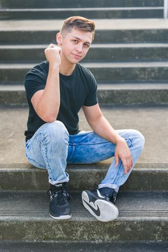 High School Senior photos of a young man on location in downtown Edmonds