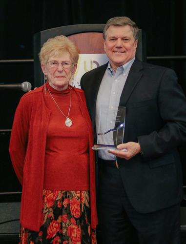 Eric Peterson receives Trusted Advisor Award presented by Ann Hall