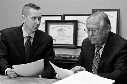 David Healy and David Appleby discuss a client's estate planning documents.