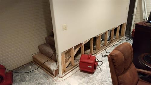 Basement water damage restoration in process.