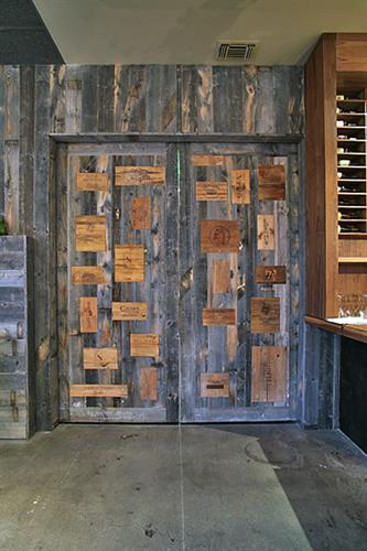 Custom door made with reclaimed wood and wine crates installed in CA.