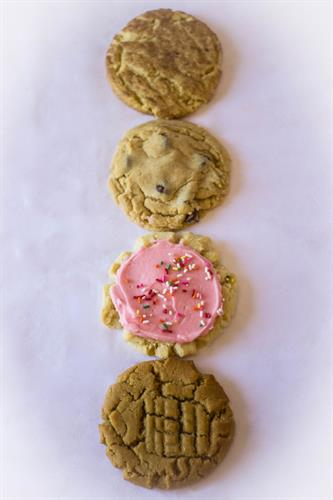 Snickerdoodle, chocolate chip, pink frosted sugar and peanut butter