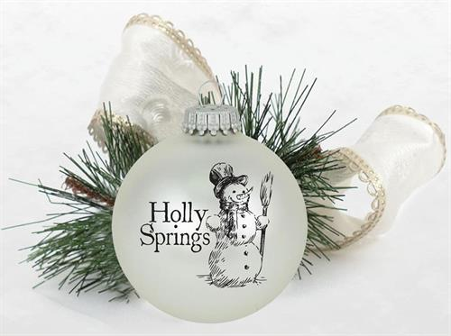 Christmas Ornaments - a hand-drawn image of a snowman imprinted on a glass ball