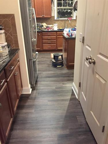 luxury vinyl plank flooring installation in kitchen for fuquay varina home https://www.a1floorsnc.com/vinyl-flooring/