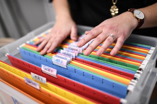 Filing system for storing kids' artwork by grade