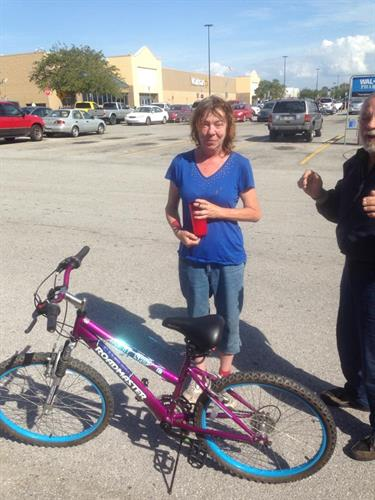 Messengers of Hope Mission giving a bike to the homeless