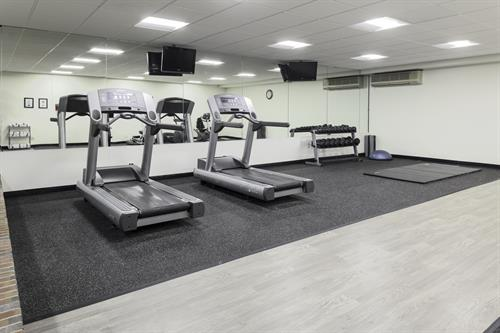 Keep up with your workout routine in our extensive fitness center.