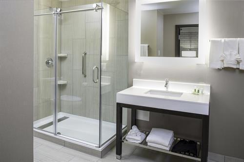 Newly modernized, spacious guest bath.