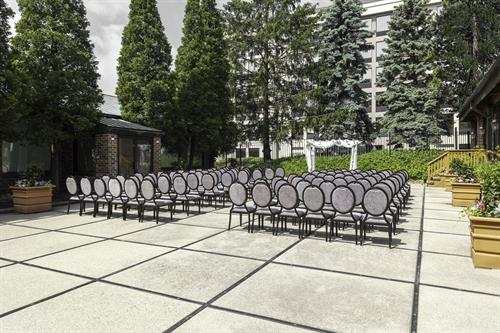 Private outdoor patio hosts intimate wedding ceremonies or corporate cocktail parties!