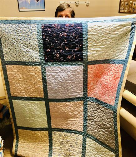 Block style quilt made from cotton/cotton blend gowns