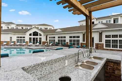 Entertain a group or grill dinner for one in our outdoor kitchen, overlooking our beautiful pool!