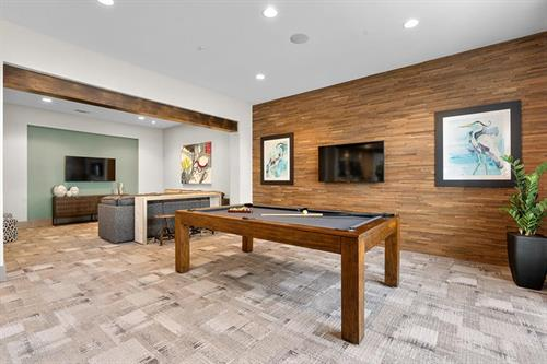 Enjoy a game of pool in our relaxing, modern clubhouse!