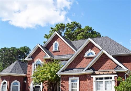 We replaced the roof on this beautiful home with CertainTeed Landmark Pro. The homeowner chose the color of moire black!
