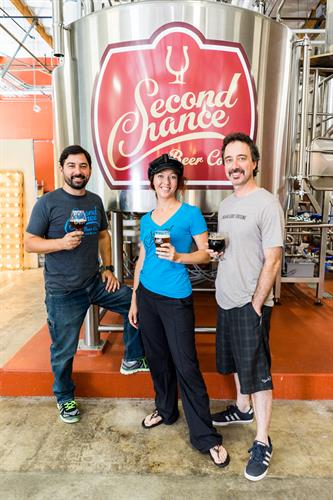 "Our Co-Founder, Curtis, Virginia & Marty, who you frequently will find at the brewery blissfully talking ""shop"""