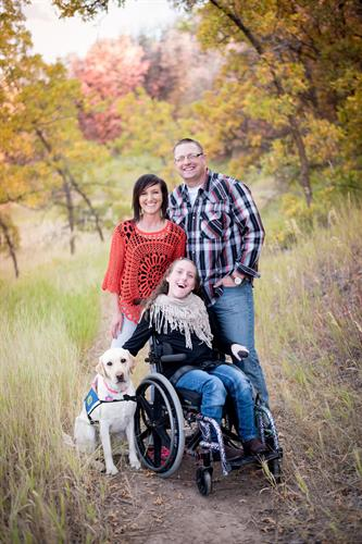 Family with assistance dog