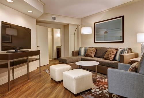 Enjoy an upscale experience in our two bedroom Presidential Suite, equipped with a dining table for 6, work station, and spacious living room